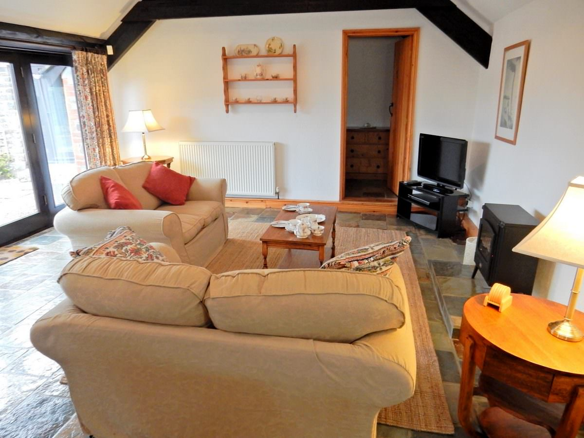 The Lounge Area in Hydrangea. Hydrangea is a one bedroom holiday cottage in North Devon    Downe